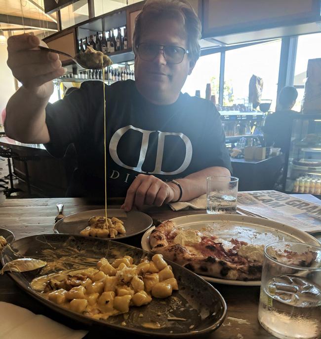 Ed eating gnochi at Perrotas, Cairns