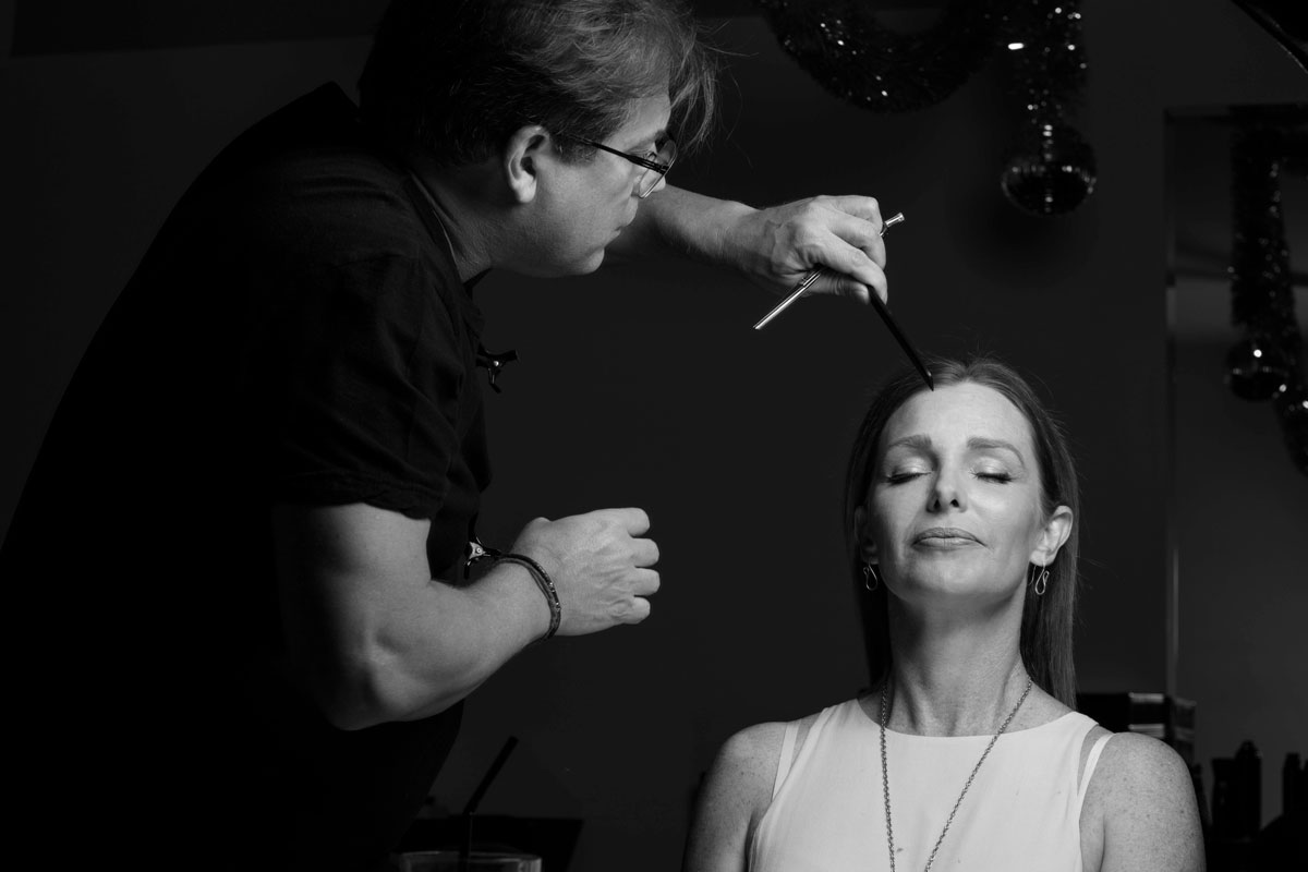 Photo of Ed working on Lisa's hair from Divine Hairdressers